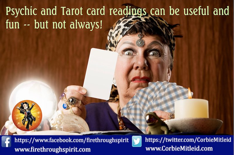 A scary-looking older woman with a crystal ball, gypsy headscarf and jewelry holds up a tarot card